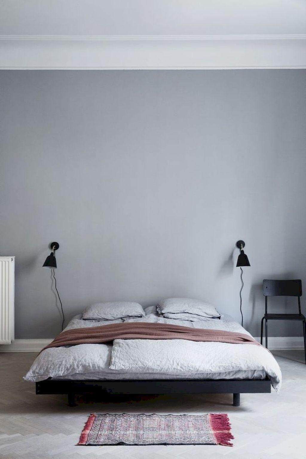 Black Scandinavian wall sconces in bedroom