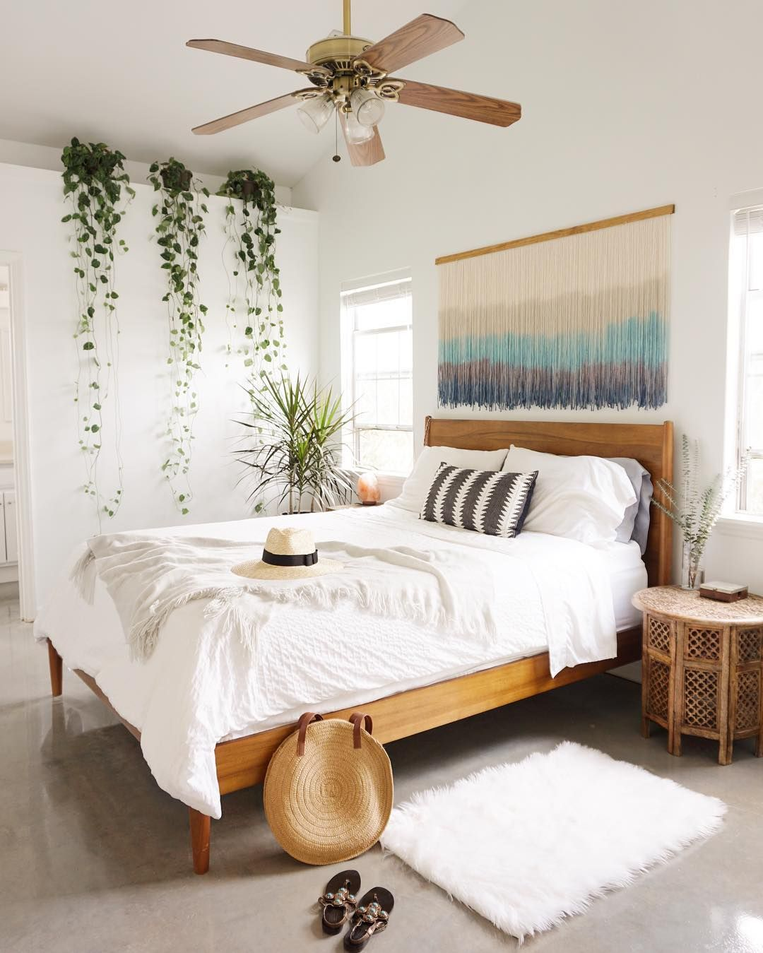 Bohemian Bedroom with draped vines and wood platform bed via @theboholoft
