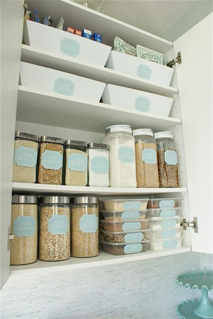 Pull-out bins for top shelf and colorful labels for jars via thesocialhome