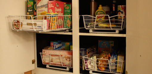 Roll out wire baskets for kitchen cabinet organization