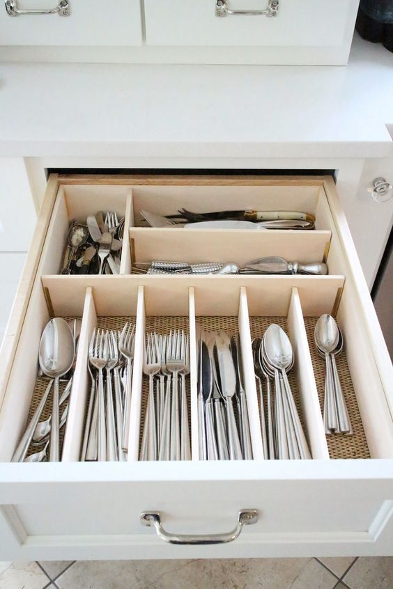 Use built-in dividers for utensil drawers