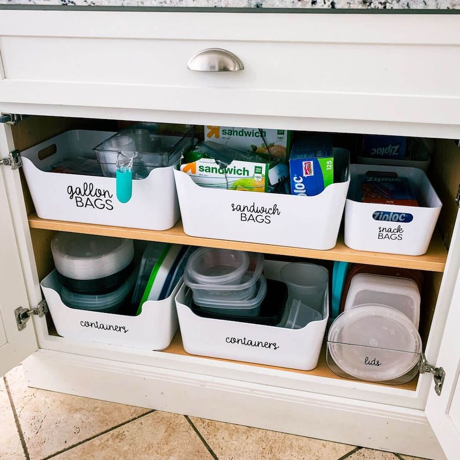 White trays with labels for kitchen cabinet organization via thirtyhandmadedays