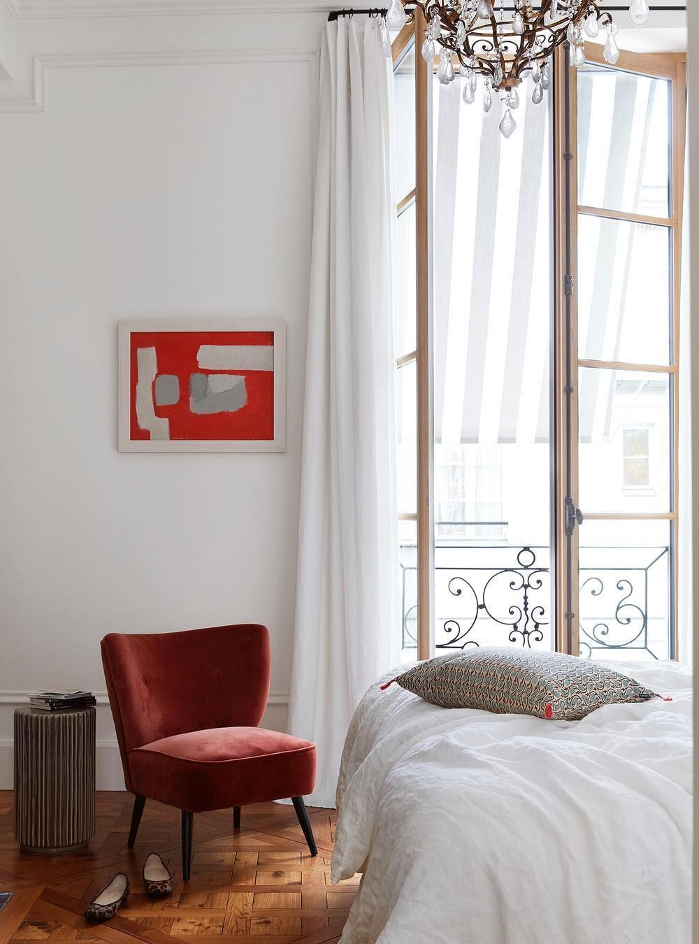 Parisian Bedroom with Red accent chair and wall art via @abkasha