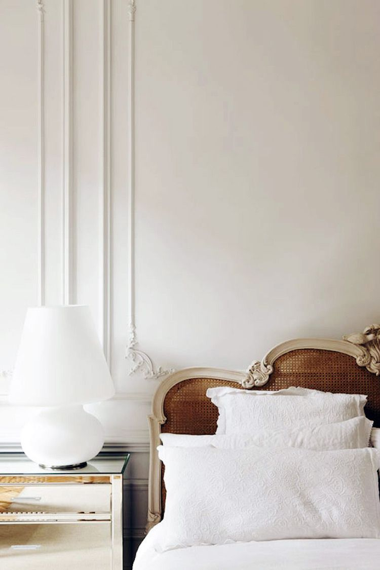Parisian bedroom with Cane headboard and mirrored nightstand