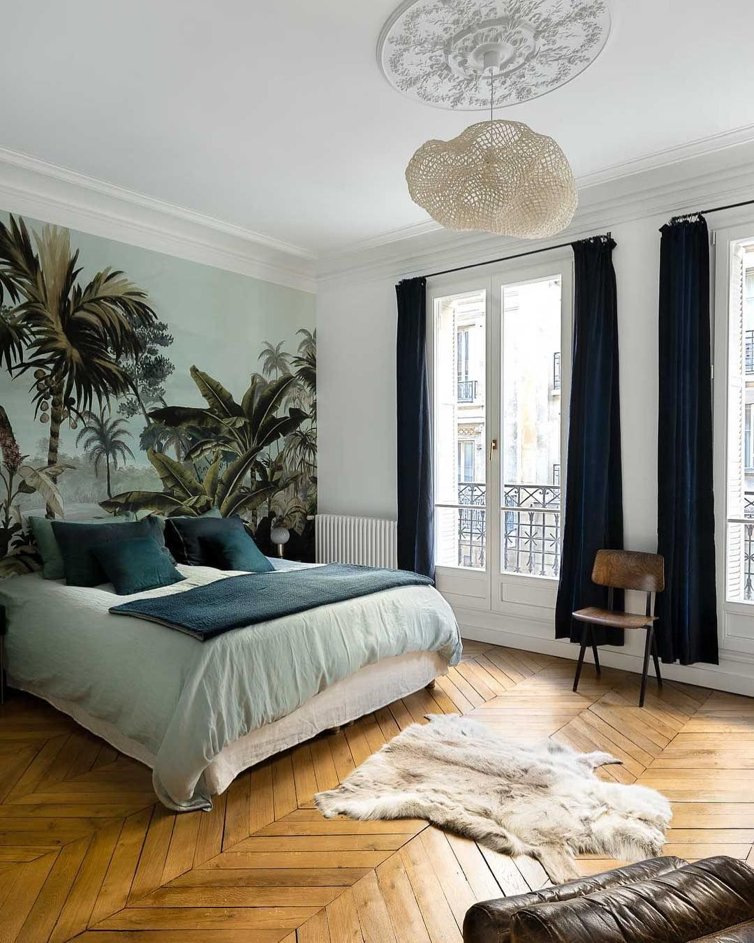 Parisian bedroom with Jungle wall mural via Charlotte Fequet