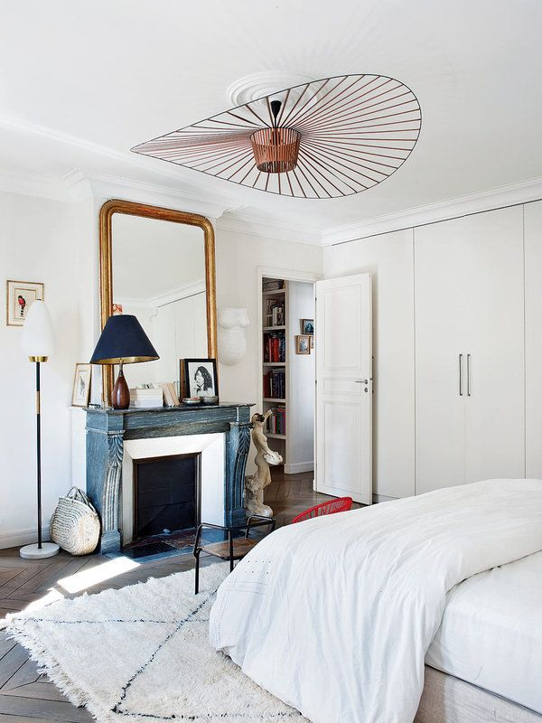 Parisian bedroom with Moroccan rug via Nuevo Estilo Caroline Gayral