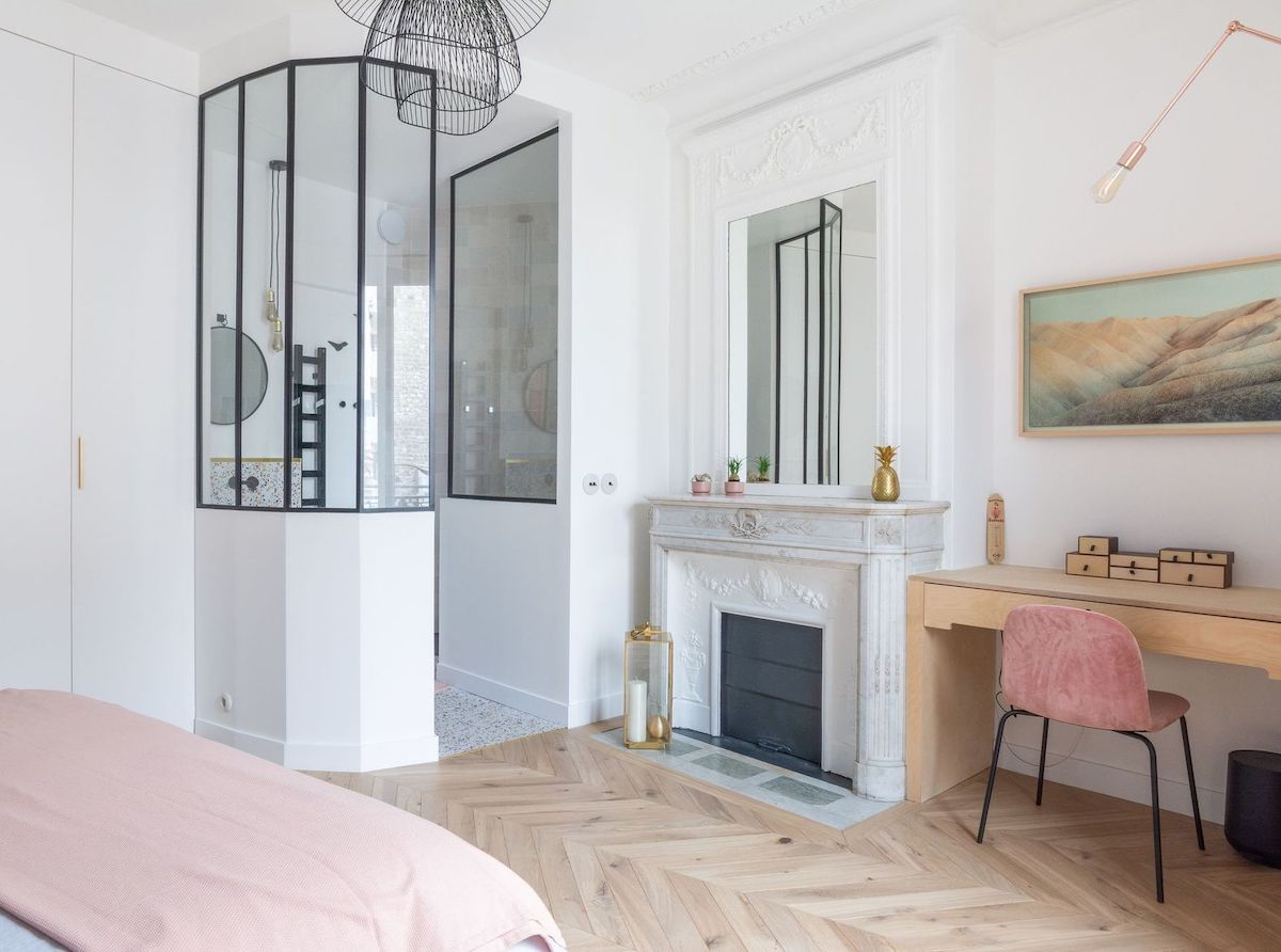 Parisian bedroom with built-in desk and pink chair via Quitterie de Pascal