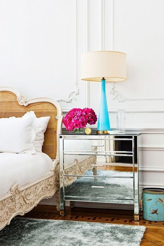 Parisian bedroom with mirrored nightstand and cane headboard