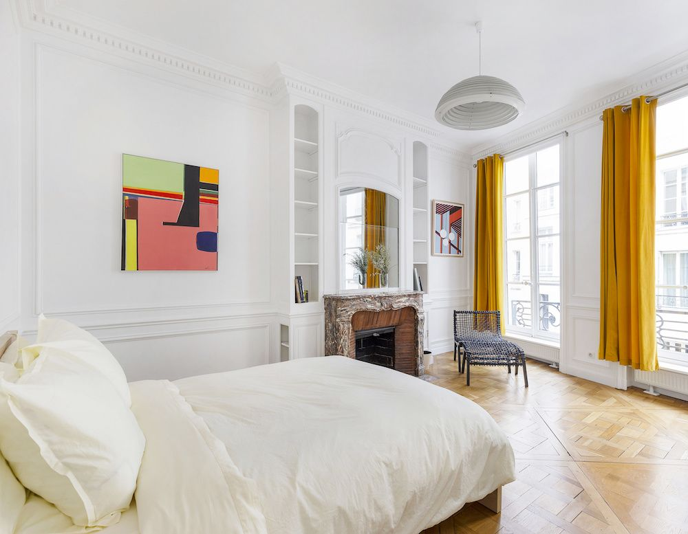 Parisian bedroom with yellow curtains via Havenin Saint Honore