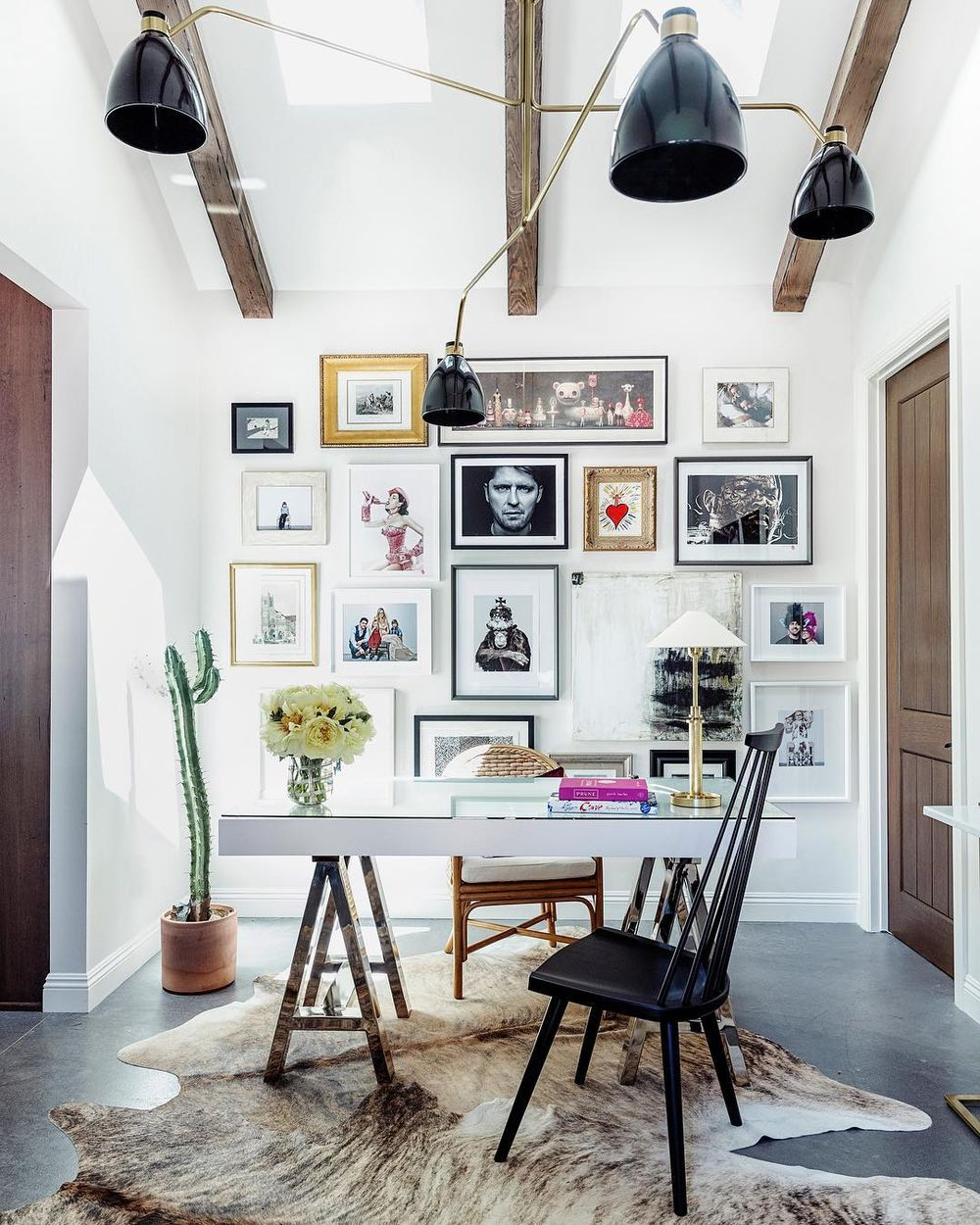 Gallery wall behind desk via @marieflaniganinteriors
