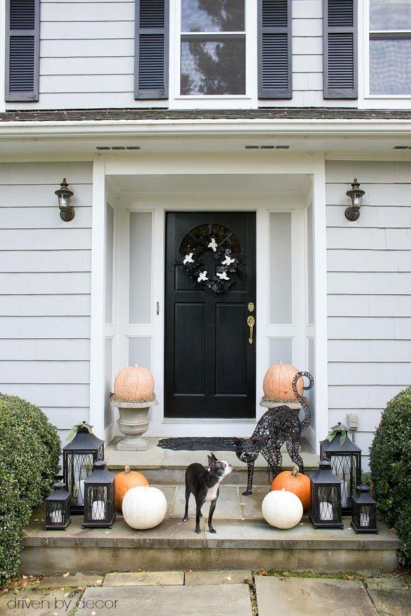Black front door Halloween decor via drivenbydecor