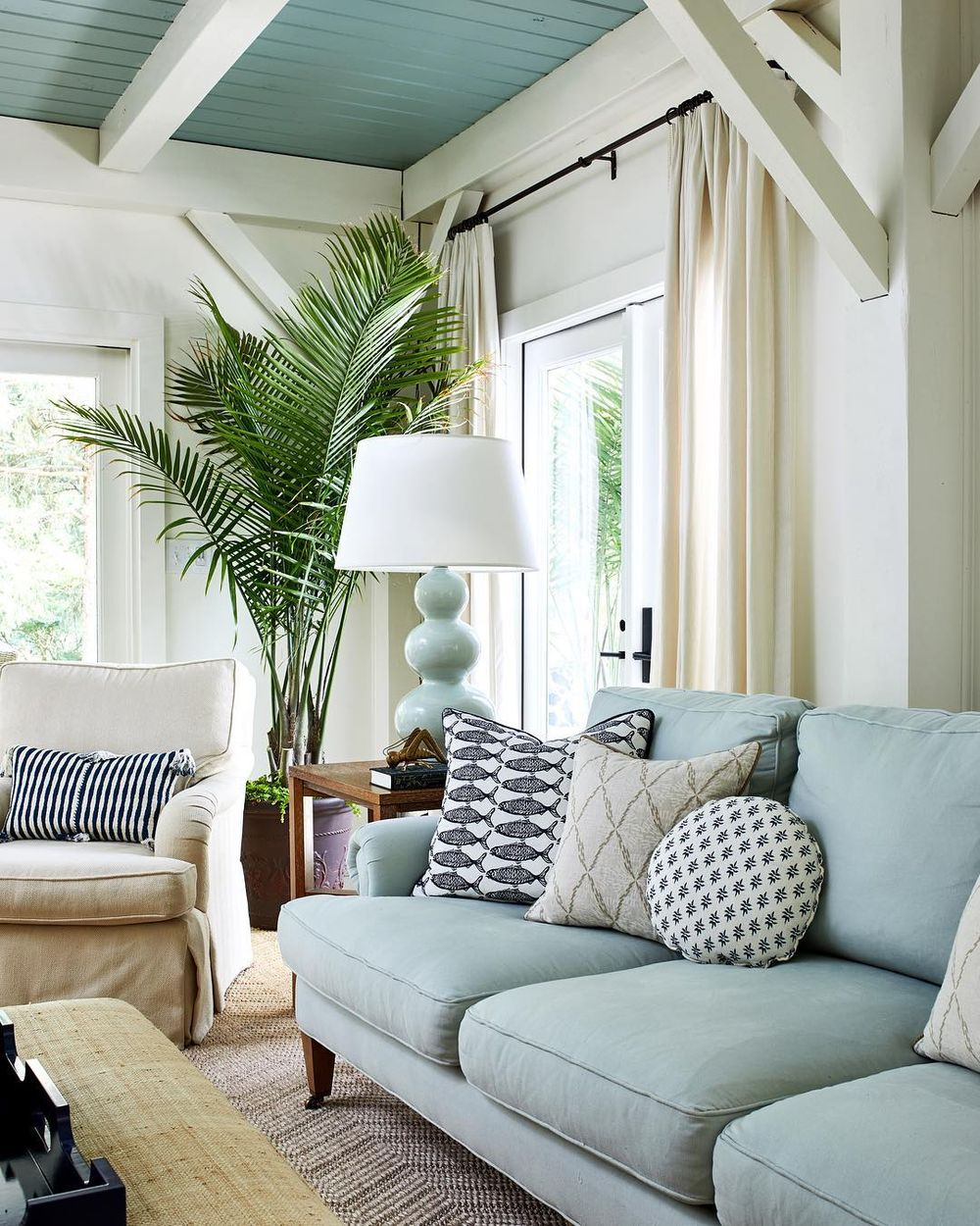 Coastal Sofas - Beach home with blue linen sofa and indoor palm @studiomiel