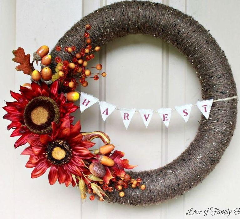 DIY Fall Yarn Harvest Wreath via loveoffamilyandhome