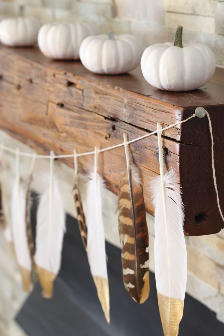 DIY Gold Tip Feather Garland via simplestylings