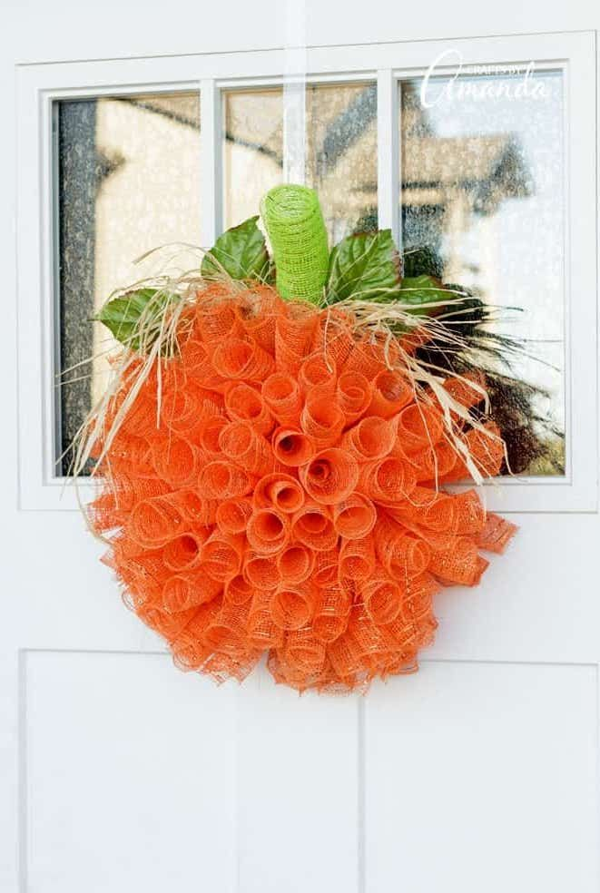 DIY Orange Mesh Pumpkin Wreath via craftsbyamanda