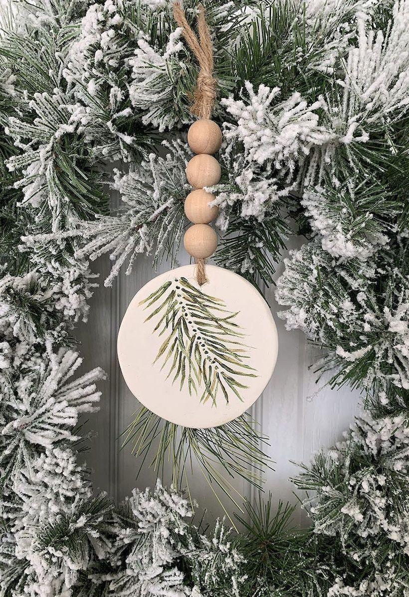 DIY Rustic Wood Bead Evergreen Ornament via madeinaday