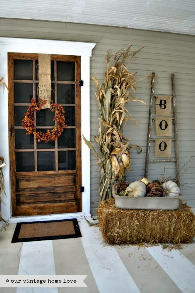 Fall front porch with Corn Stalks via ourvintagehomelove