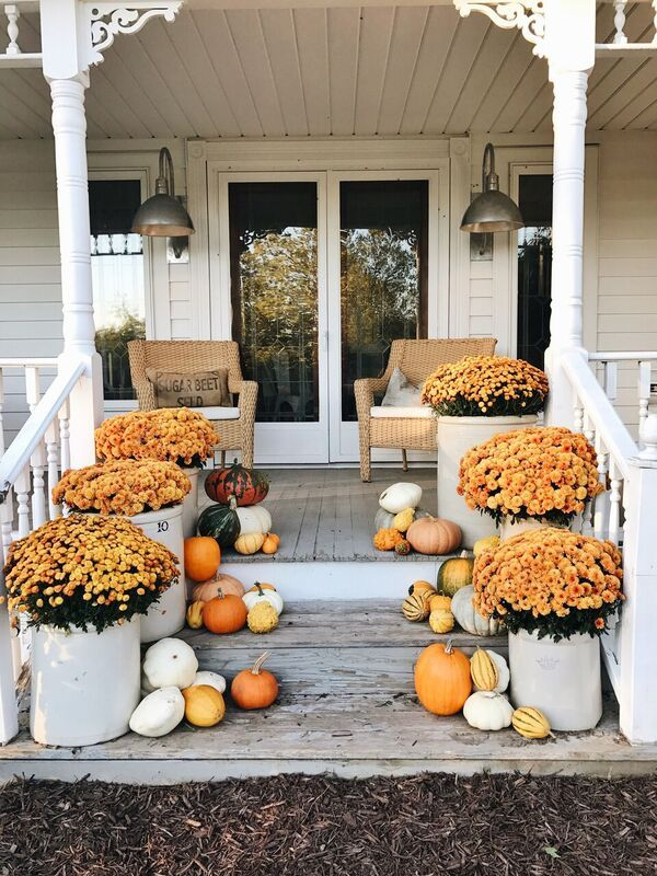 Fall front porch with Orange Mums and Gourds via Liz Marie