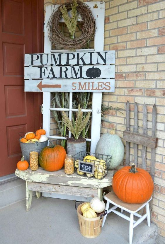 Fall front porch with Pumpkin Farm Sign