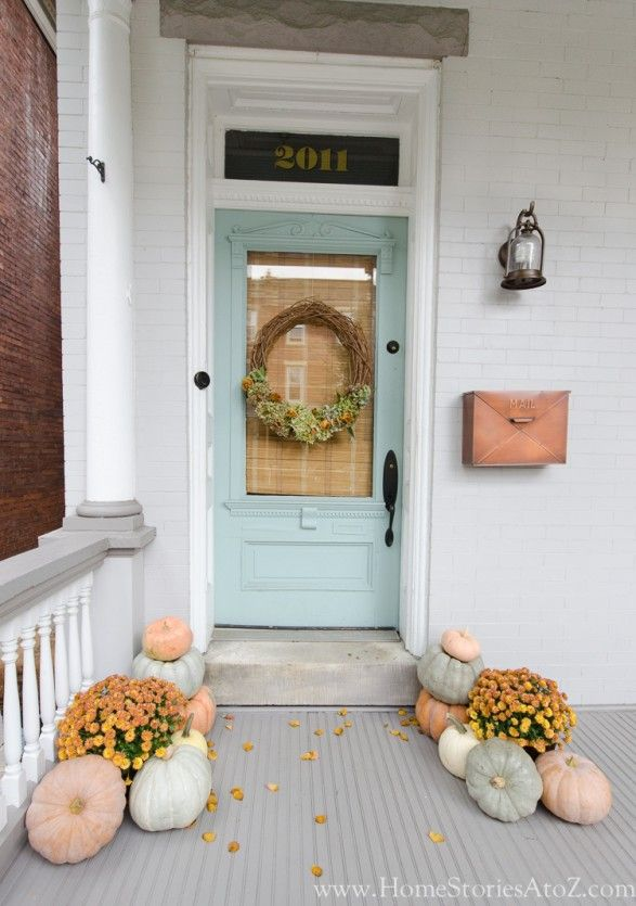 Fall front porch with faded pastel pumpkins via homestories