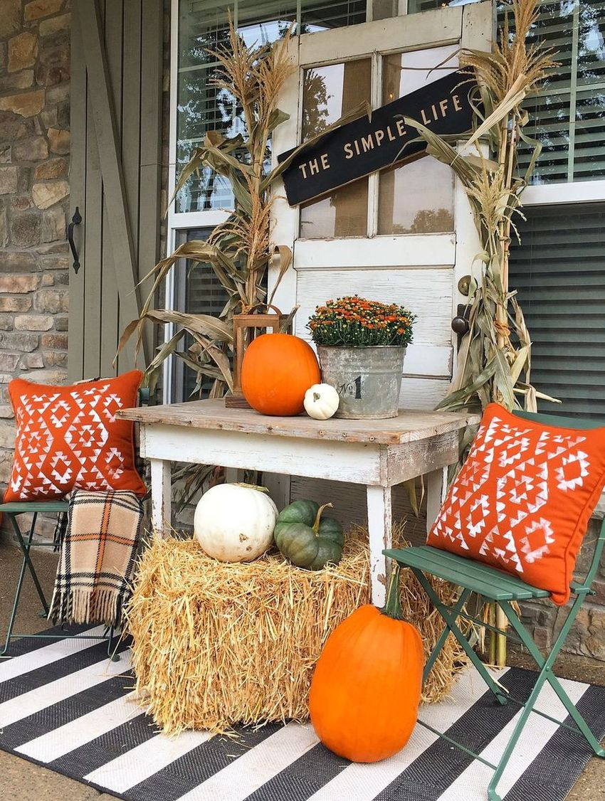 Fall front porch with old door as background vignette via yellowprairieinteriors