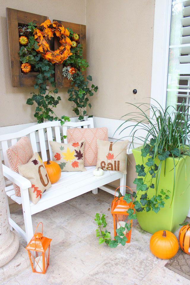 Fall front porch with orange lanterns via designimprovised
