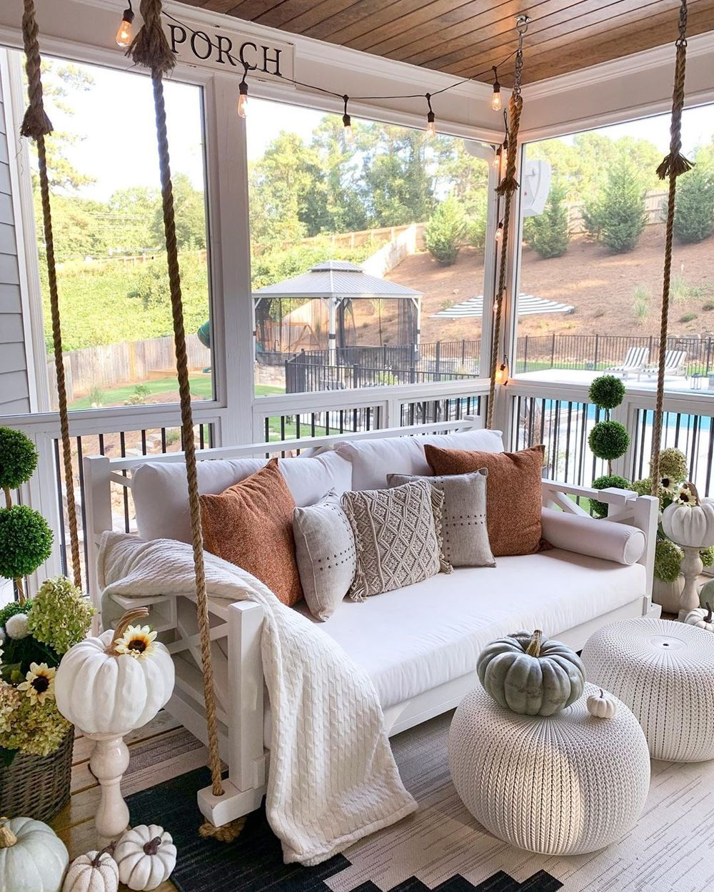 Fall front porch with rope swing with pillows via @mygeorgiahouse
