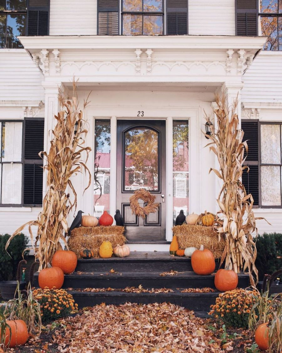 Fall front porch with steps and corn stalks via galmeetsglam