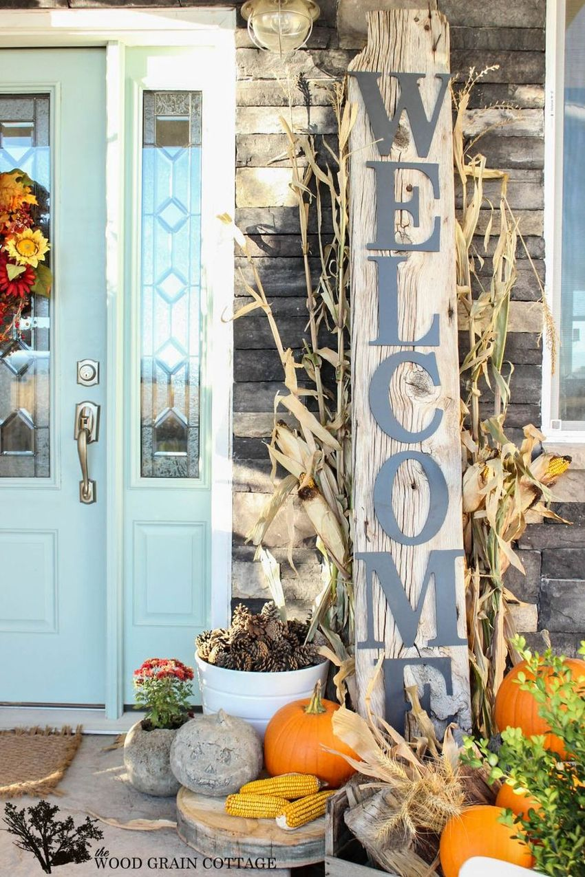 Fall front porch with vertical Welcome Sign via thewoodgraincottage