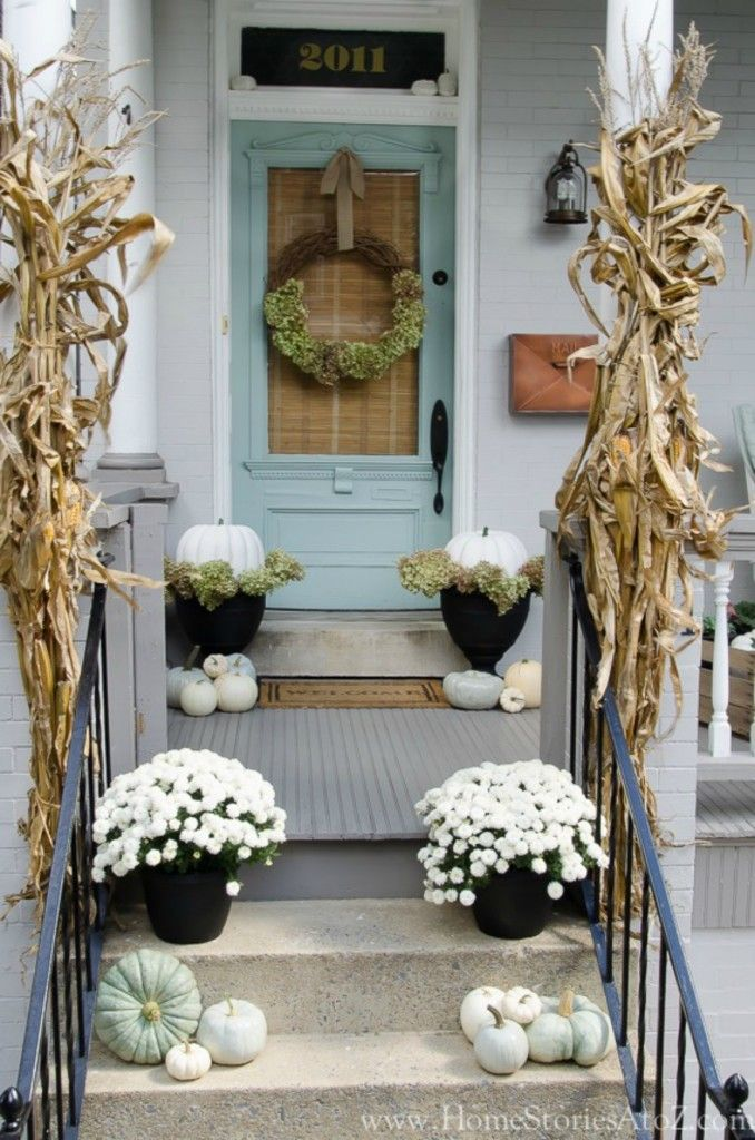 Fall front porch with white mums and green pumpkins via nestingwithgrace
