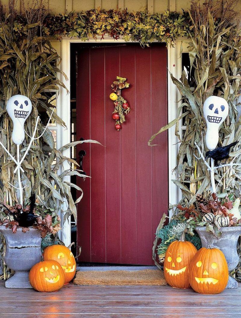 Ghosts in the cornstalks on Halloween front porch decor via GlassShopLocal