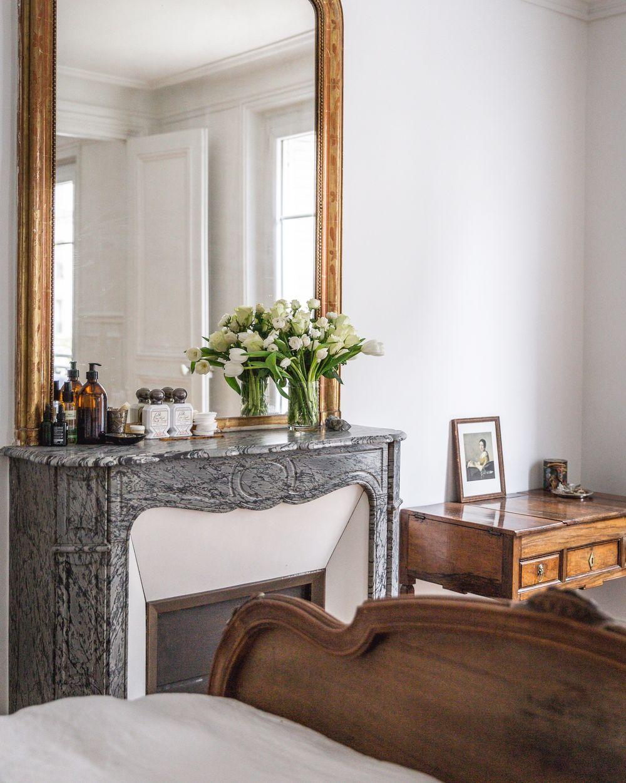 Gray marble Parisian Fireplace in Bedroom via AptLafayetteParis