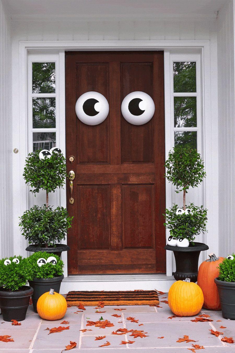 Halloween Front Door with Googly Eyes via House Beautiful
