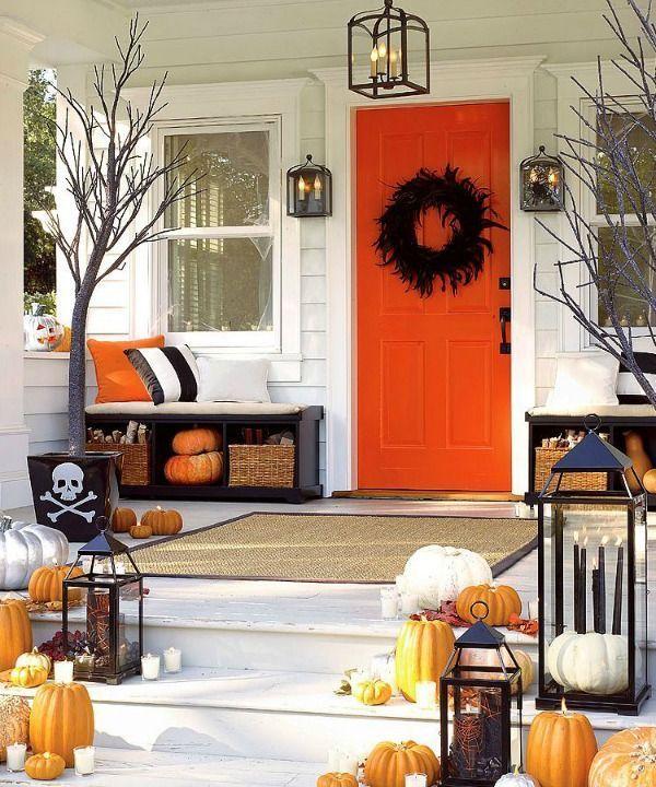 Halloween front porch decor with orange front door via infarrantlycreative