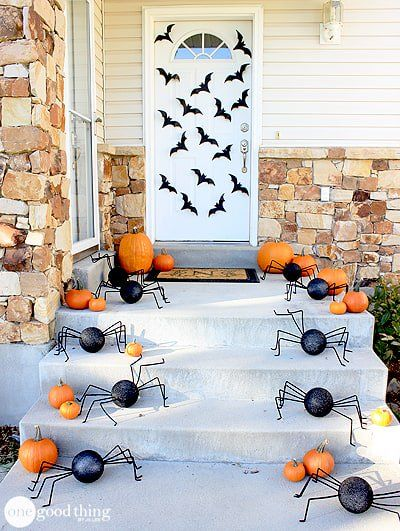 Halloween front porch decor with spiders on porch steps via onegoodthingbyjillee