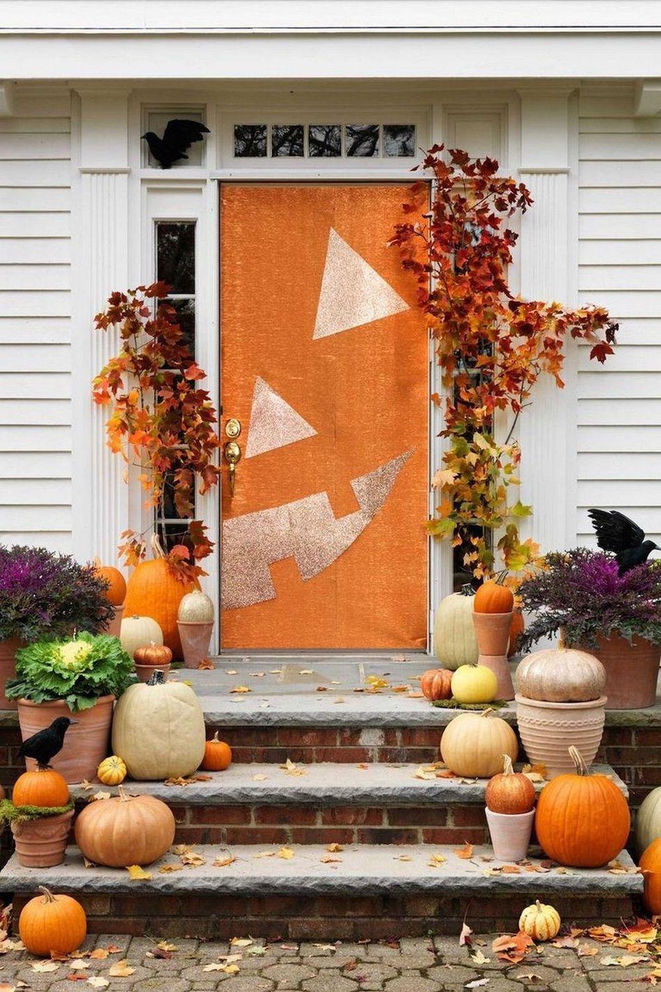 Halloween front porch decor with Pumpkin Face Door via womansday