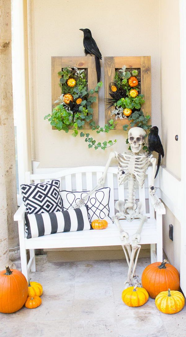 Halloween front porch decor with skeleton on bench