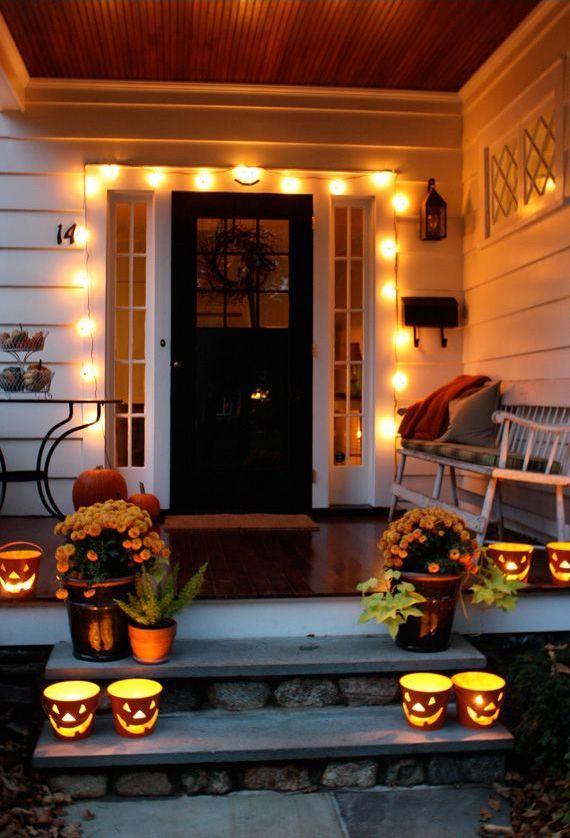 Halloween string lights around front door on the porch