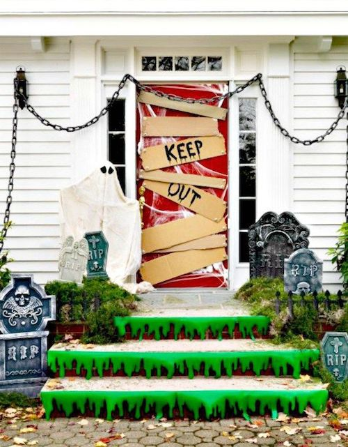 Keep out Halloween front door with green slime on steps and gravestones decor