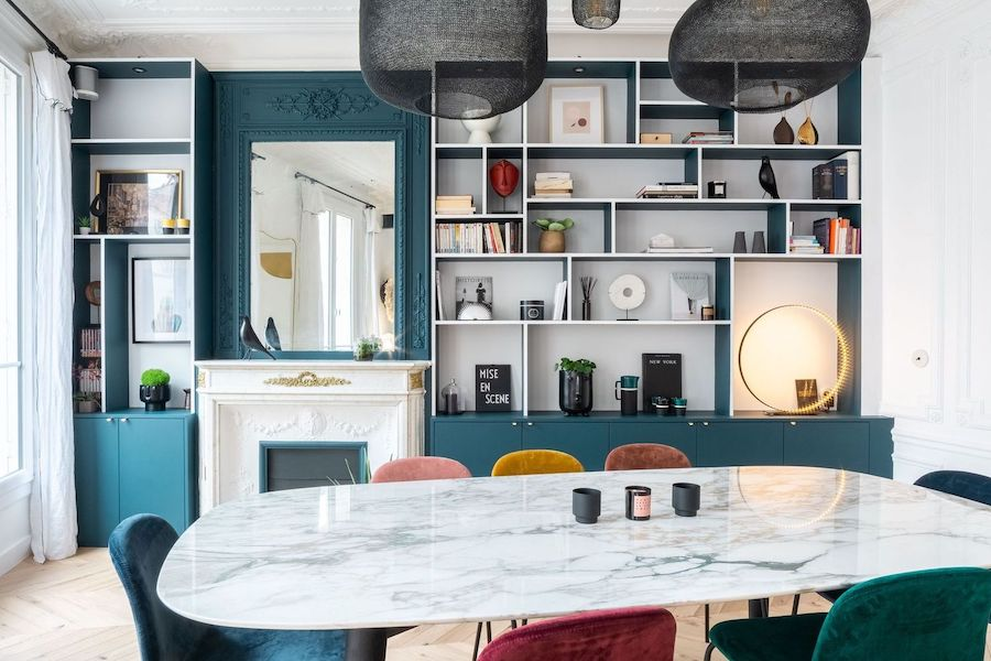 Parisian Dining room with turquoise bookshelf wall via Quitterie de Pascal