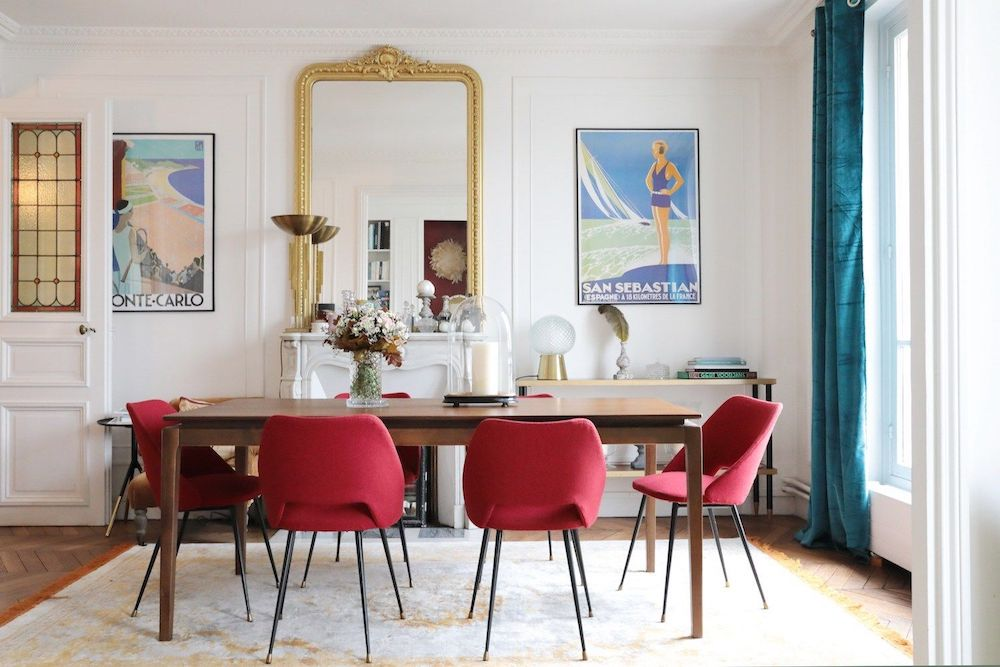 Parisian dining room decor with Vintage travel posters and mid-century modern furniture via Hello-hello Camille Omerin