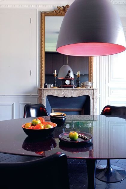 Parisian dining room with black table and chairs via CoteMaison