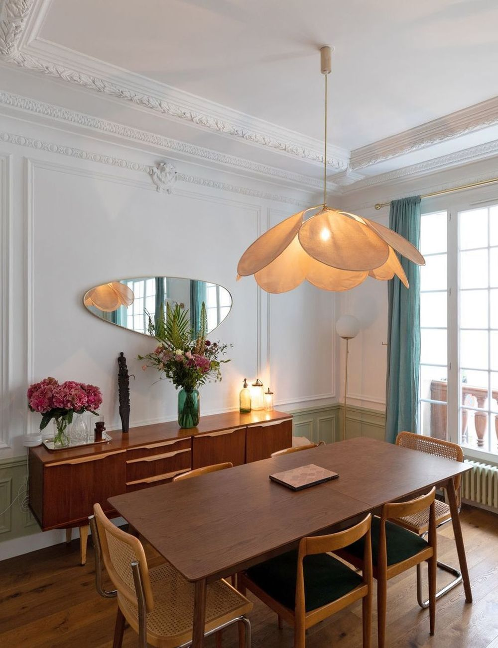Parisian dining room with mid-century modern table, chairs and credenza via Charlotte Fequet CoteMaison