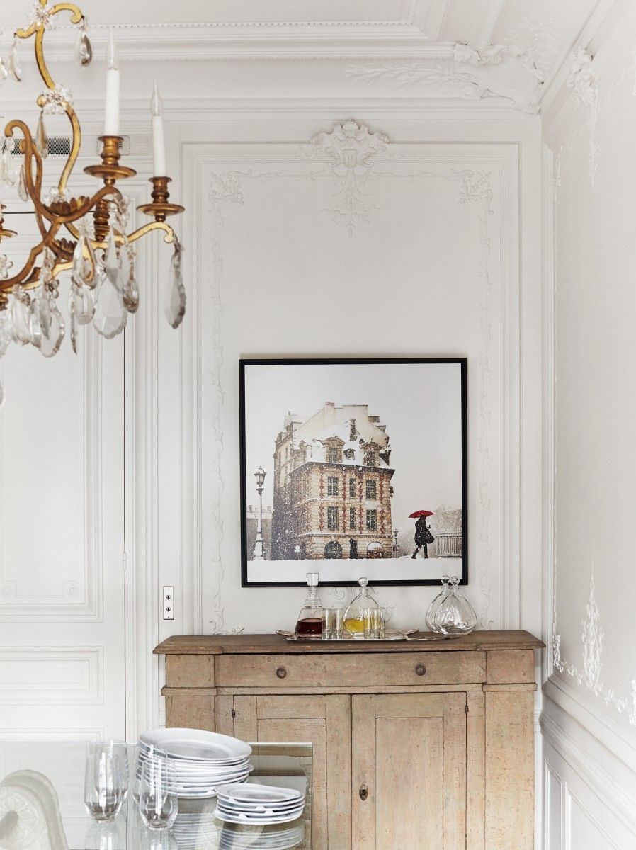 Parisian dining room design with Wood cabinet via A+B Kasha
