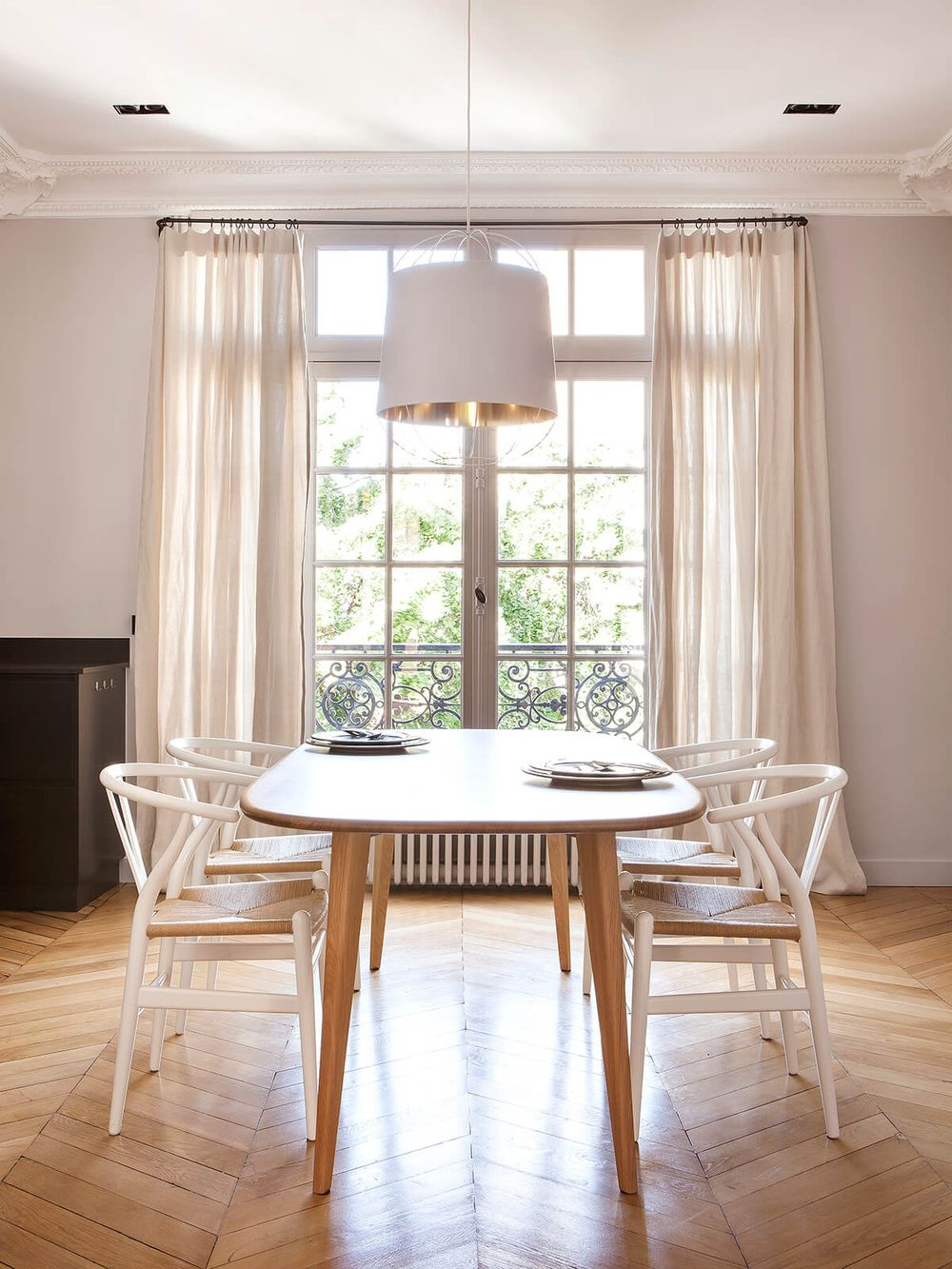 Parisian dining room decor with White wishbone chairs via Camille Hermand