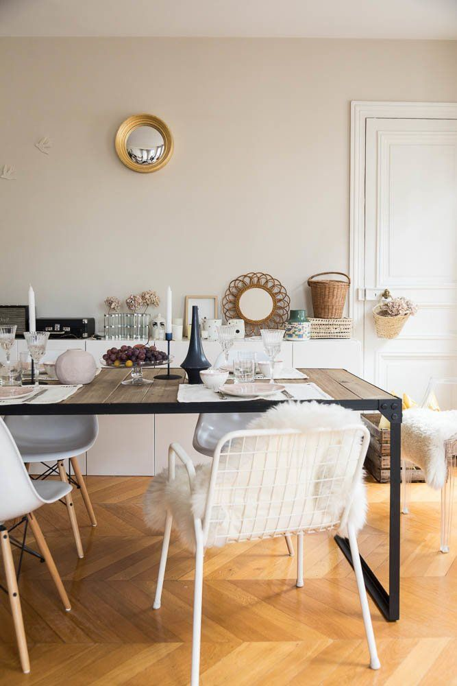 Parisian dining room with Bohemian decor, mismatched chairs and sheepskin seat cushions via The Socialite Family Audrey Borrego