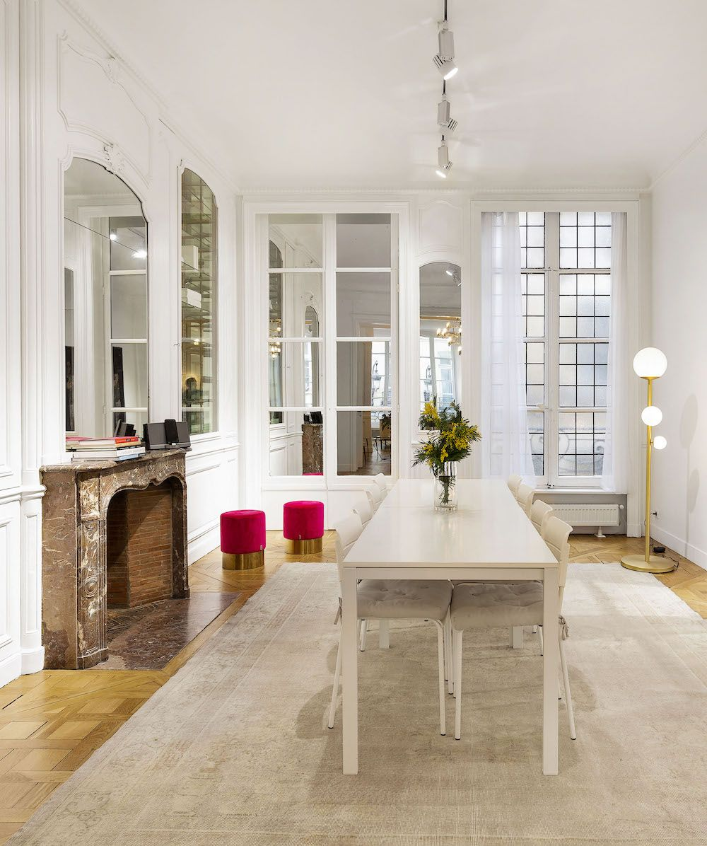 Parisian dining room with Off-white rug and white furniture via Havenin Saint Honore
