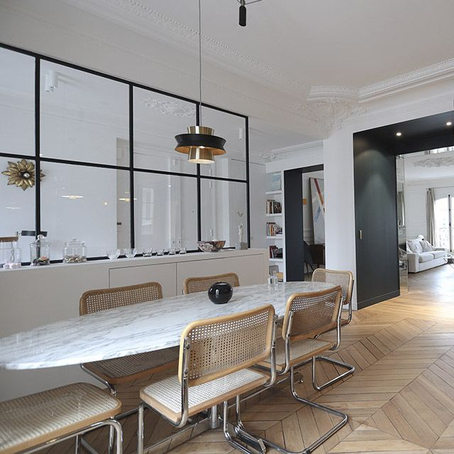 Parisian dining room design with Breuer chairs and oval marble dining table via miresparis