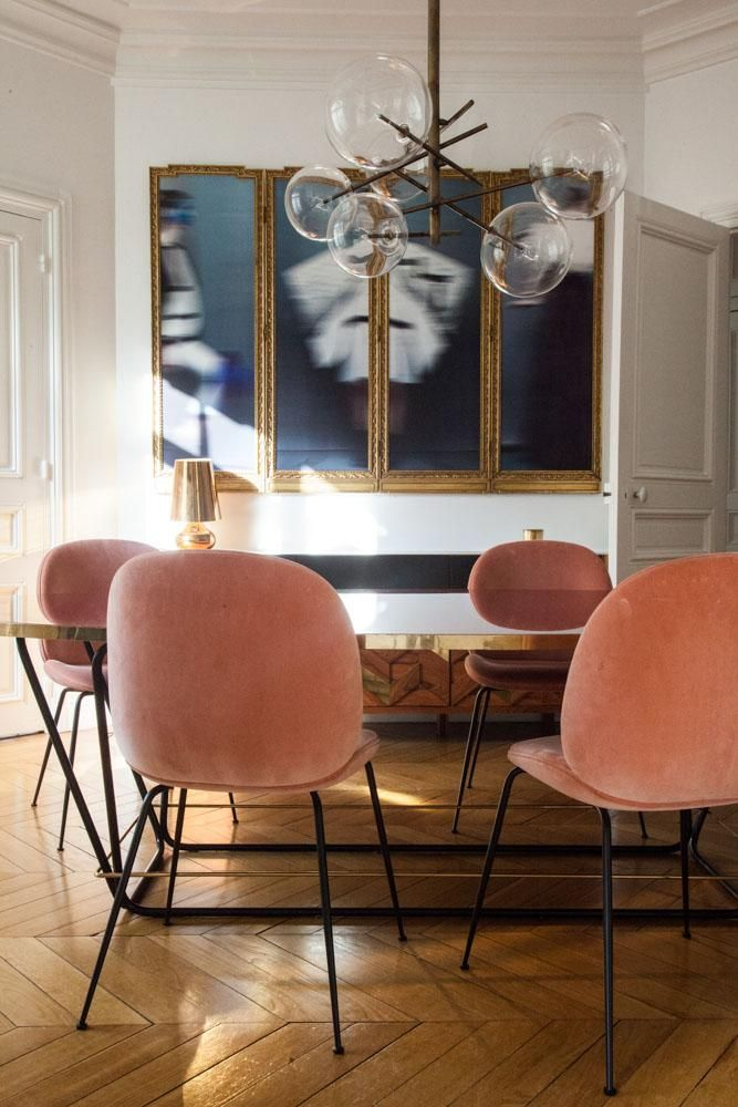 Parisian dining room with mid-century glass ball chandelier and pink dining chairs via The Socialite Family Aroussia Chamakh