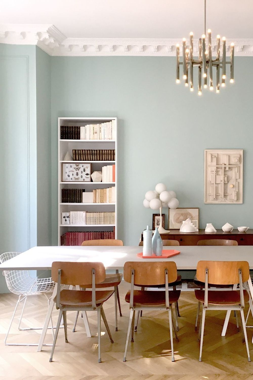 Parisian dining room with mint walls and thrifted dining chairs via CoteMaison DPLG Suzanne Tanascaux